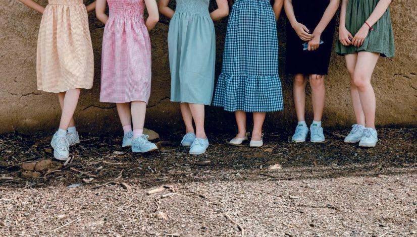 Canva - Women Standing Wall